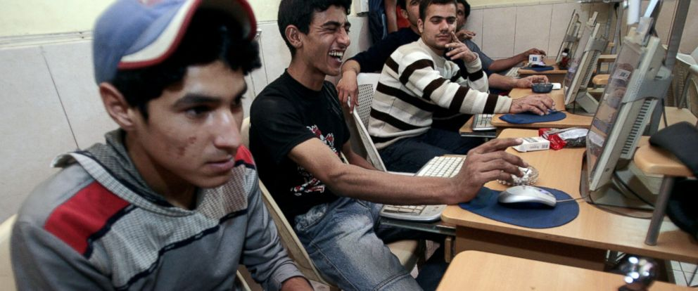 PHOTO: Iraqi youths surf the web at an internet cafe in Baghdad, March 19, 2008.