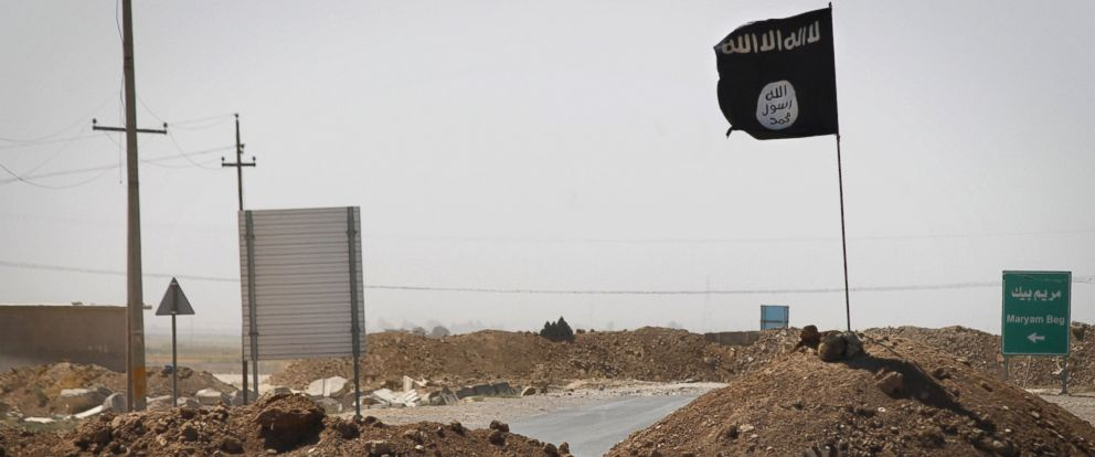PHOTO: A flag of the Islamic State (IS) is seen on the other side of a bridge at the frontline of fighting between Kurdish Peshmerga fighters and Islamist militants in Rashad, on the road between Kirkuk and Tikrit, on Sept. 11, 2014.