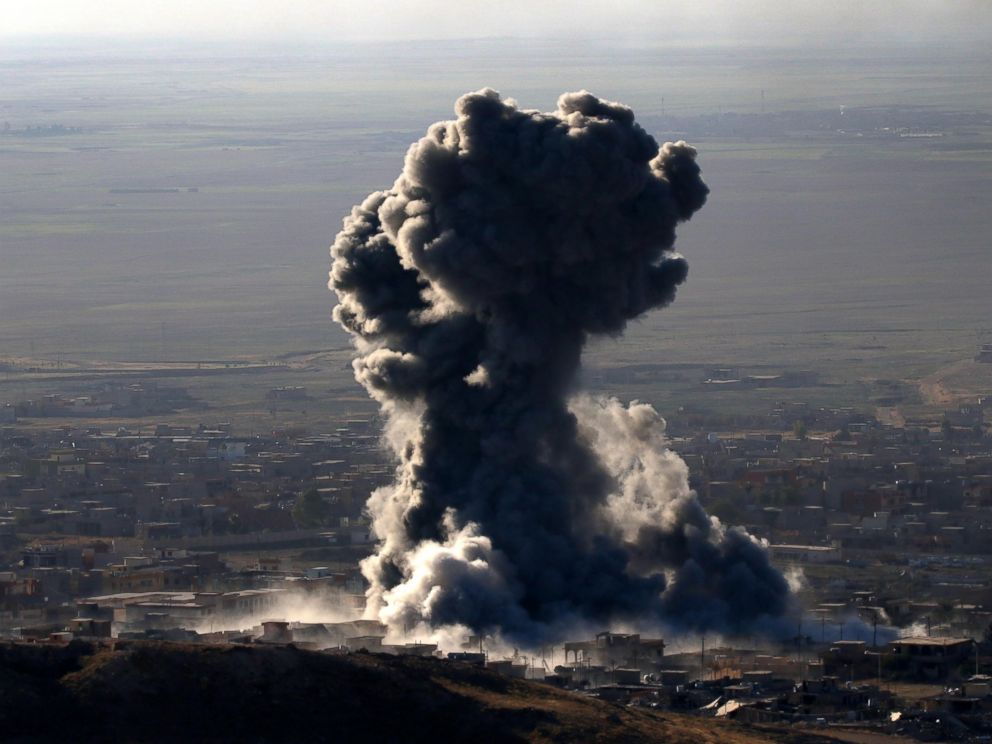 PHOTO: Heavy smoke billows during an operation by Iraqi Kurdish forces backed by US-led strikes in the northern Iraqi town of Sinjar on Nov. 12, 2015, to retake the town from the Islamic State group.