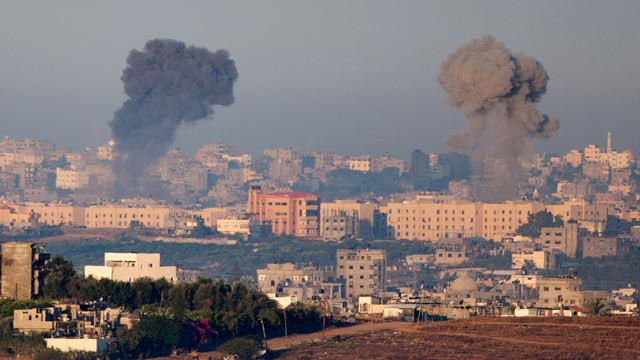 PHOTO: Plumes of smoke rise over Gaza during an Israeli air strike, as seen from Sderot on November 15, 2012 in Israel.