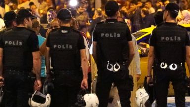 PHOTO: Turkish police blocks the road as relatives wait outside the Turkeys largest airport, Istanbul Ataturk, following the suicide bomb attack, June 28, 2016 in Istanbul, Turkey