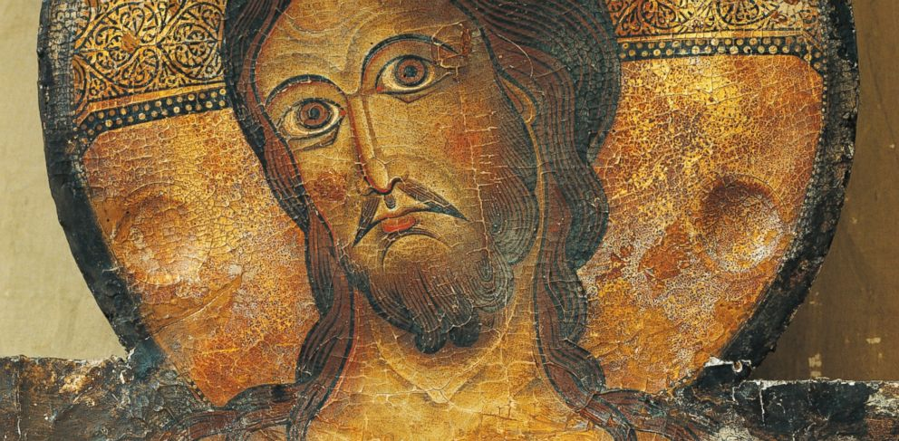 PHOTO: Christs face is seen in a detail from the Crucifix, 1187, by Alberto Sotio, Cathedral of the Assumption of Mary, Spoleto, Umbria, Italy.