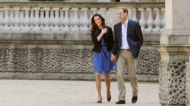 PHOTO: Prince William, Duke of Cambridge and Catherine, Duchess of Cambridge walk hand in hand from Buckingham Palace on April 30, 2011 in London, England.