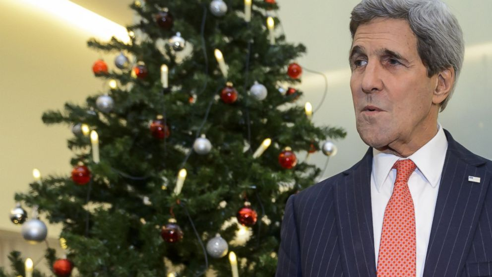 PHOTO: Secretary of State John Kerry gestures as he stands next to a Christmas tree on the eve of an Organization for Security and Cooperation in Europe ministerial meeting in Basel, Switzerland, Dec. 3, 2014.