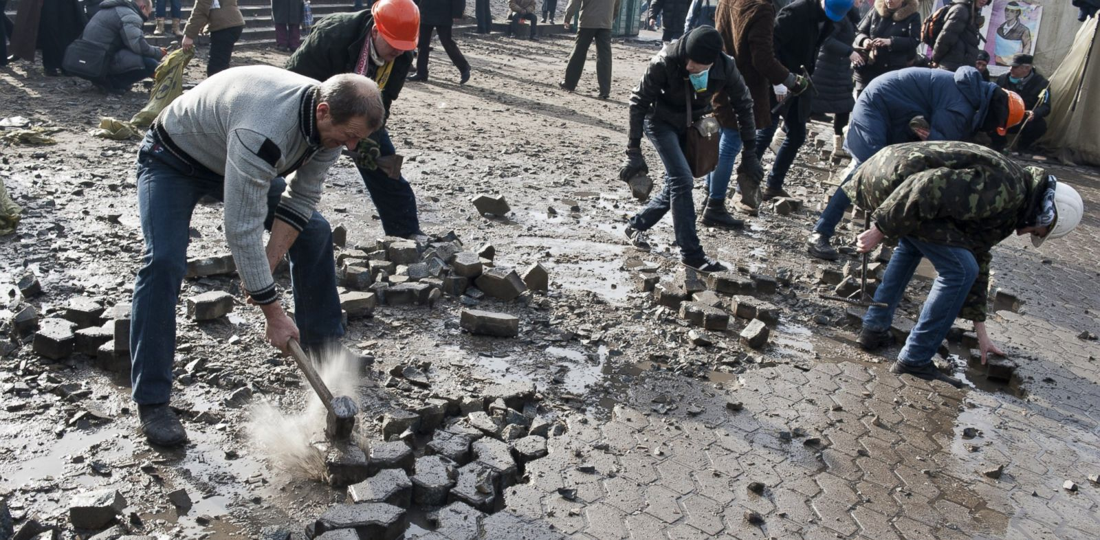 PHOTO: Anti-government protesters dig up cobblestones to use them as rocks against riot police on Kievs Independence square, Feb. 19, 2014.