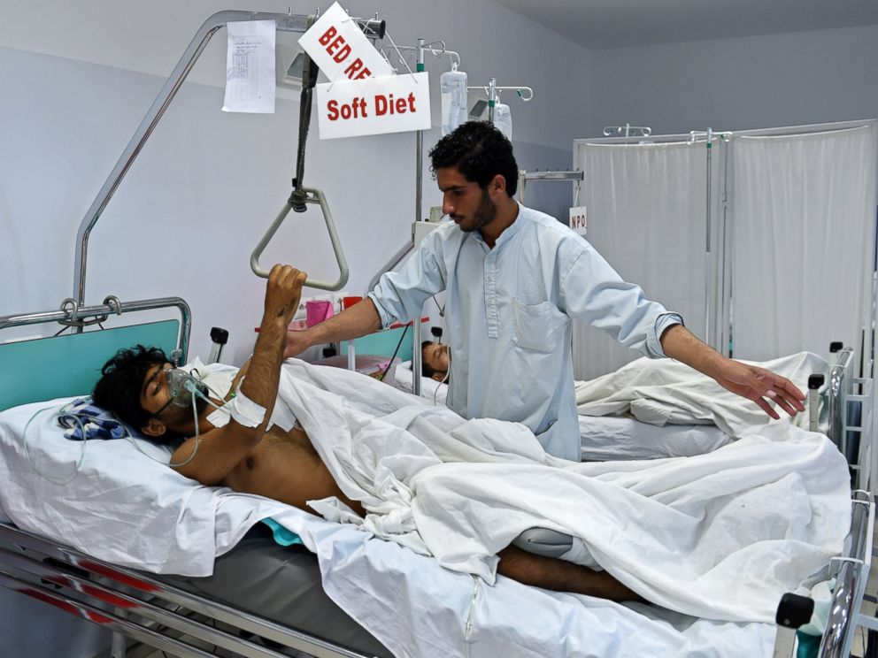 PHOTO: A wounded staff member of Doctors Without Borders who survived the bombing of the MSF Hospital in Kunduz receives treatment at an Italian aid organizations hospital in Kabul on Oct. 6, 2015.