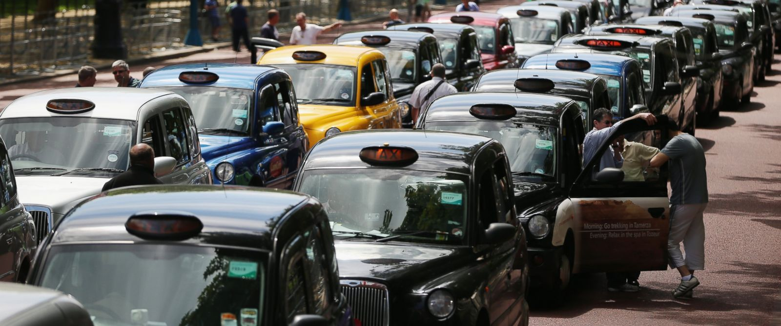 PHOTO: London taxis line up on The Mall during a protest against a new smart phone app, Uber on June 11, 2014 in London, England.