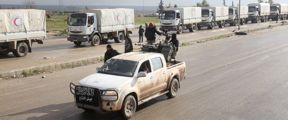 PHOTO: A vehicle belonging to an Islamist rebel faction drives along convoys from the Syrian Arab Red Crescent carrying aid for the besieged towns of Fuaa and Kafraya, in Syrias northwest Idlib province, on January 14, 2016.