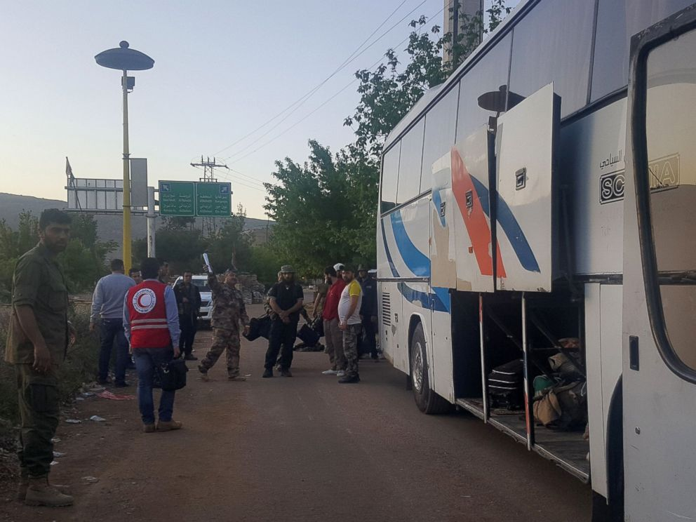 PHOTO: Syrians prepare to board a bus to leave the besieged town of Madaya, on April 20, 2016 during an operation to evacuate hundreds of wounded people from besieged Syrian towns.