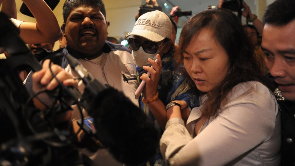 PHOTO: Chinese relatives of passengers from the missing Malaysia Airlines flight 370 are prevented from entering the media centre before the start of a press conference in Sepang, outside Kuala Lumpur, March 19, 2014.