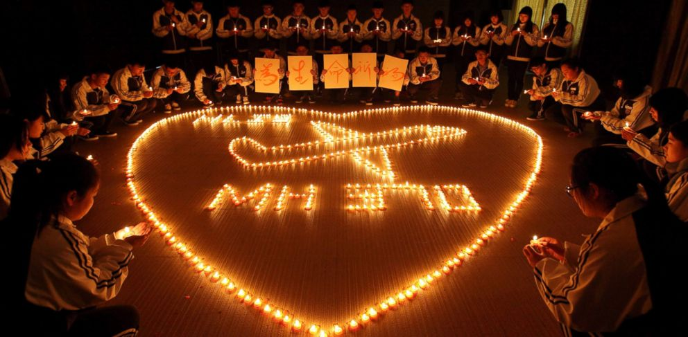 PHOTO: Students from an international school in east China city Zhuji pray for the passengers onboard Malaysia Airlines flight MH370 by lighting candles on March 10, 2014 in Zhuji, China.
