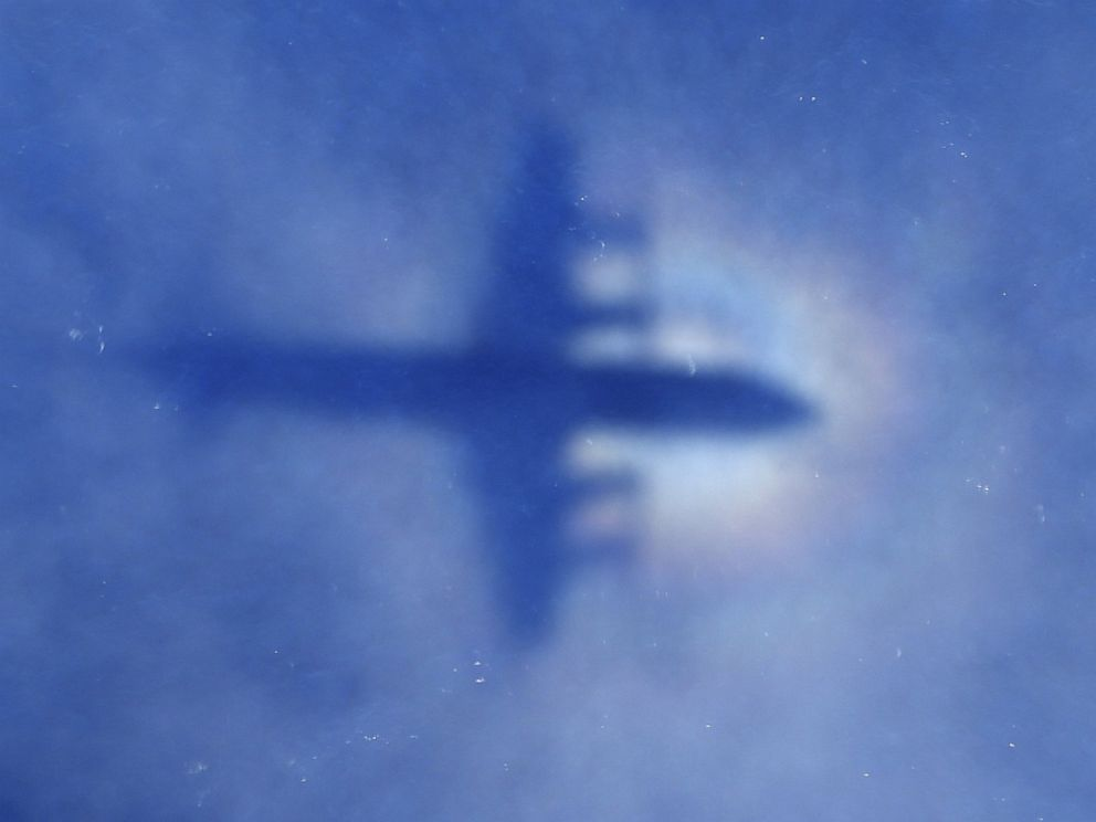 PHOTO: This shadow of a Royal New Zealand Air Force P3 Orion aircraft is seen on low cloud cover while it searches for missing Malaysia Airlines flight MH370, over the Indian Ocean on March 31, 2014.