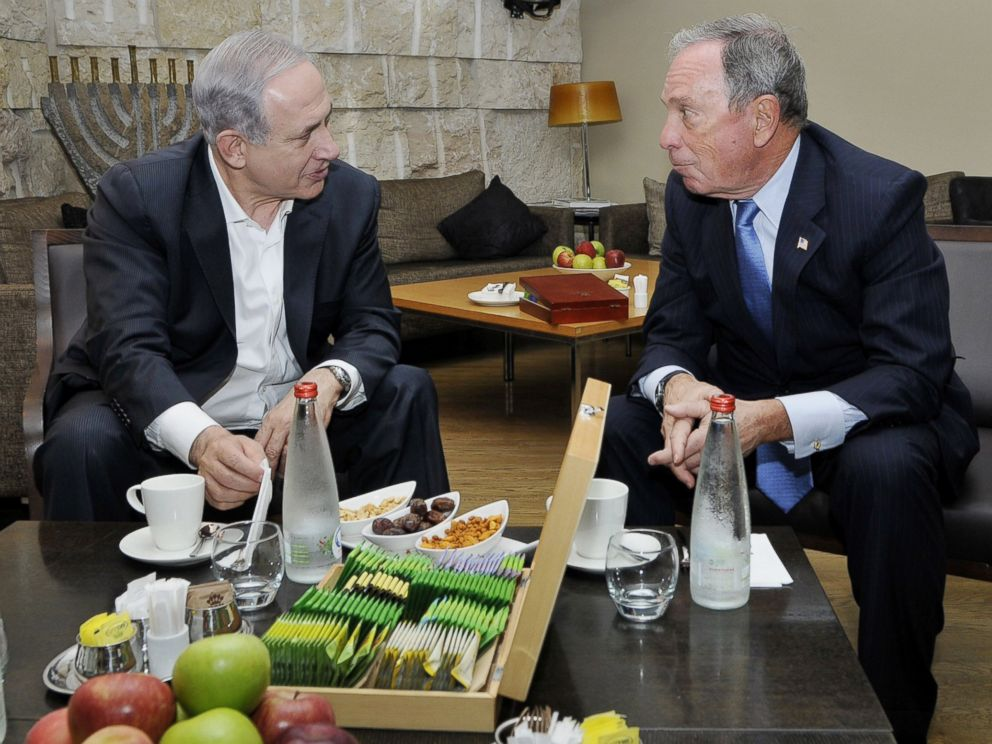 PHOTO: Israels prime minister, Benjamin Netanyahu, speaks with Michael Bloomberg at Ben Gurion International Airport near Tel Aviv, Israel on July 23, 2014.