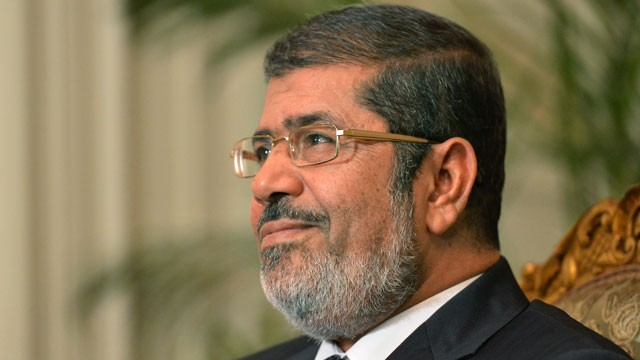 PHOTO: President Mohamed Morsi attends a meeting with UN Secretary General Ban Ki-moon (unseen) at the presidential palace in Cairo, November 21, 2012.
