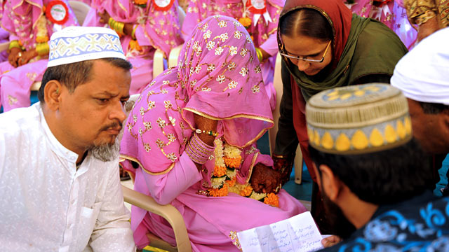 "PHOTO: An Indian Muslim bride, center, answers questions by religious leaders during the ""Nikah Kabool Hai"" or ""Do You Agree for the Marriage."""