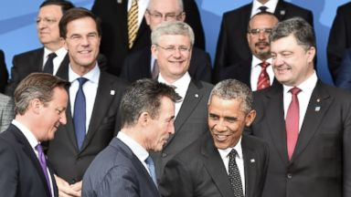 PHOTO: David Cameron, Barack Obama and Anders Fogh Rasmussen arrive for a picture at the start of the NATO 2014 summit in Newport, South Wales, on September 4, 2014.