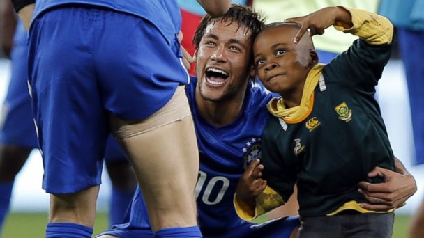 gty naymar brazil wy 140406 16x9 608 Brazilian Striker Neymar Scoops Up Tiny Field Invader