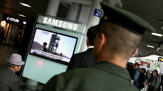 PHOTO: A South Korean marine watches a television report on North Korea's rocket launch at Seoul Station in Seoul, South Korea, April 13, 2012.