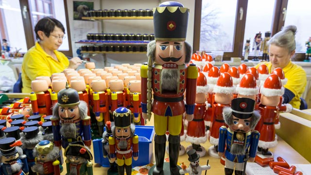 PHOTO: The Artisans, Martina Beyer, left, and Christina Reimer, at the Seiffener Volkskunst Christmas decorations manufactory assemble nutcrackers on Nov. 20, 2012 in Seiffen, Germany.