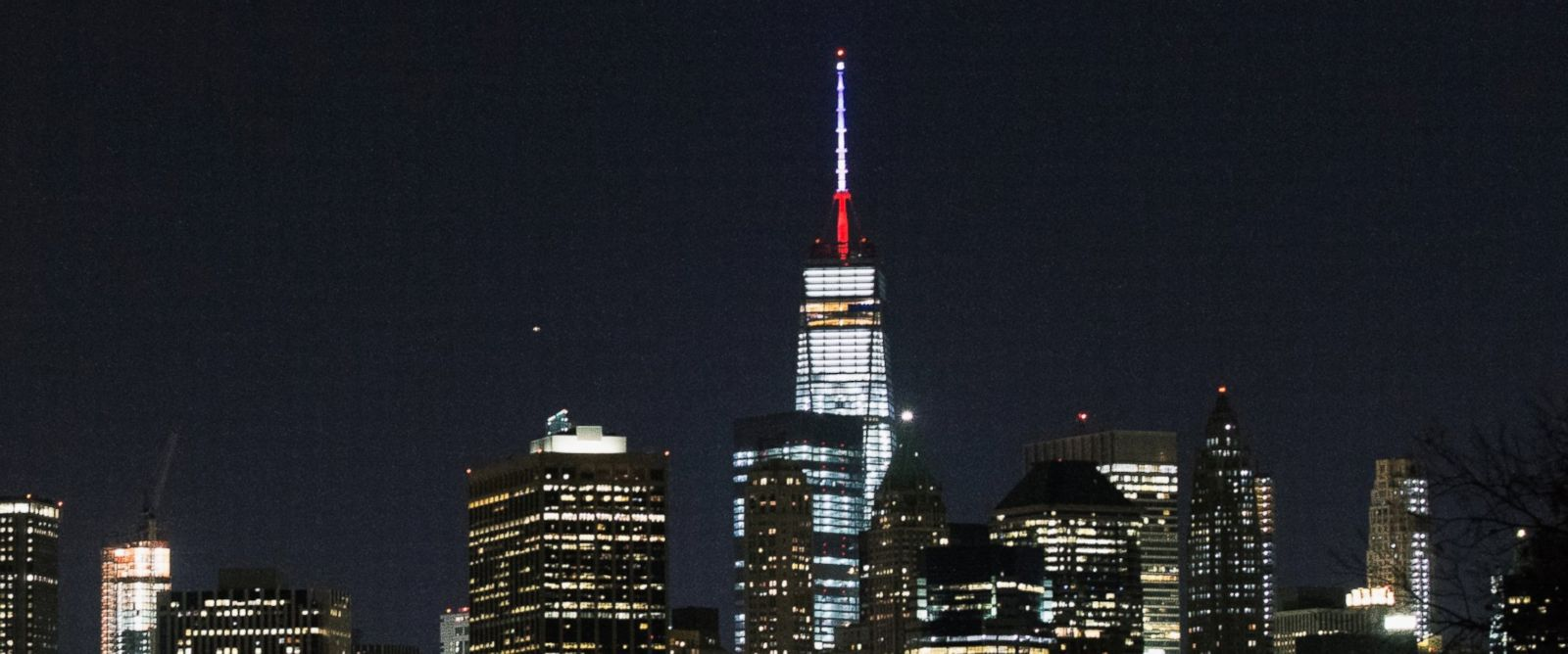 PHOTO: One World Trade Centers spire is shown lit in French flags colors of white, blue and red in solidarity with France after tonights terror attacks in Paris on Nov. 13, 2015, in New York City.