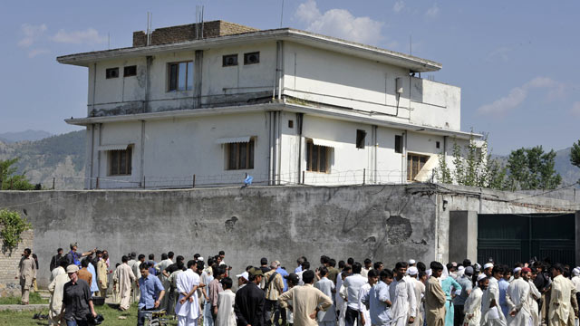 PHOTO: Pakistani media personnel and local residents gather outside the hideout of Al-Qaeda leader Osama bin Laden following his death by US Special Forces in a ground operation, May 3, 2011, Abbottabad, Pakistan.
