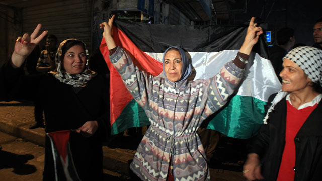 PHOTO: Palestinians celebrate in the street of Gaza City, November 21, 2012 as a ceasefire came into effect in and around Gaza after a week of cross-border violence between Israel and Hamas.