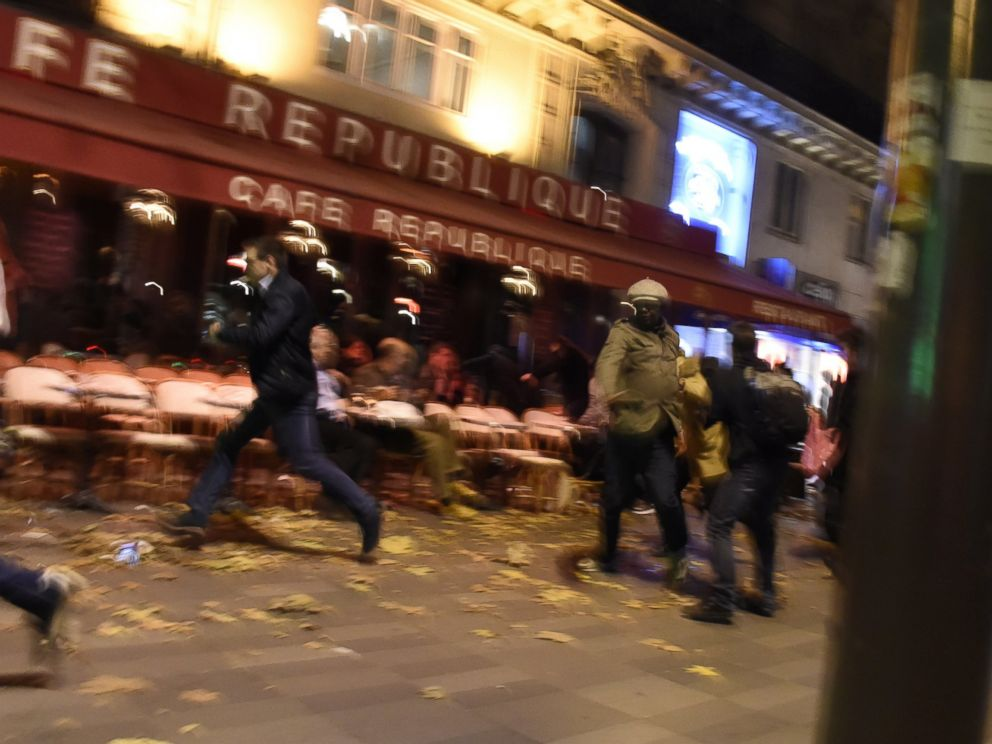 PHOTO: People run after hearing what is believed to be explosions or gun shots near Place de la Republique square in Paris on Nov. 13, 2015.