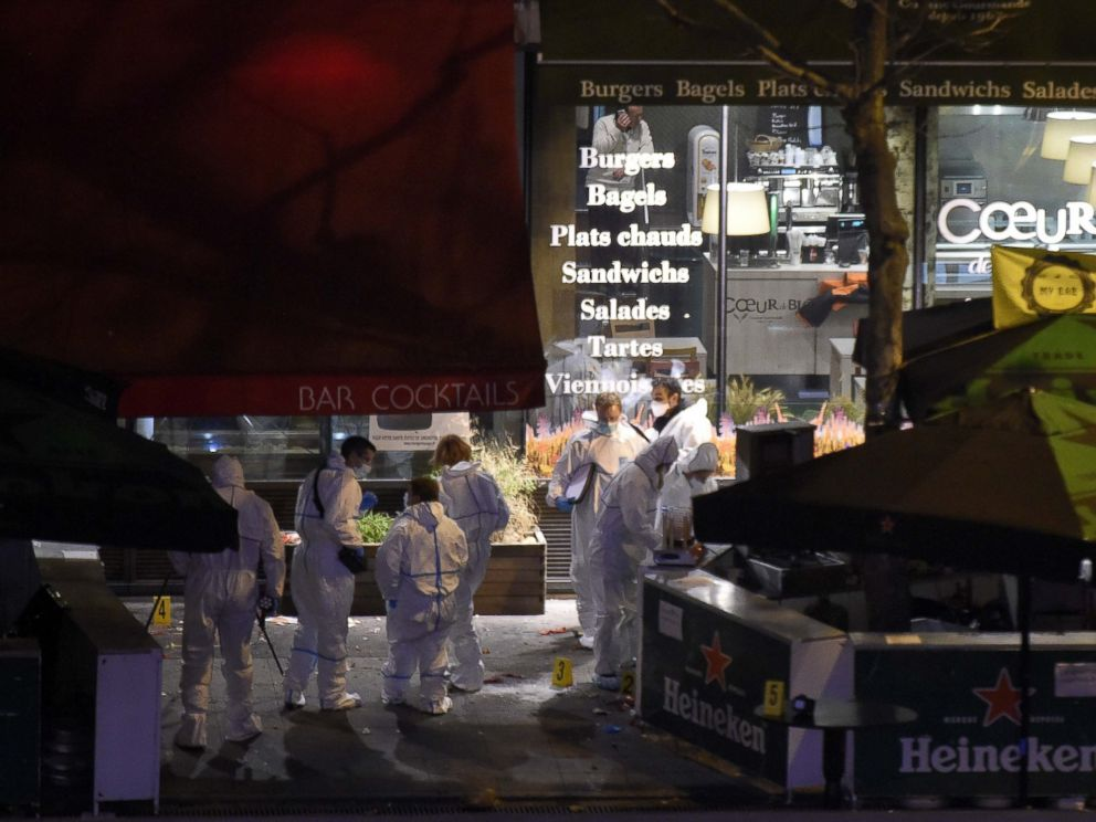 PHOTO: Forensic experts inspect the site of an attack at a restaurant outside the Stade de France stadium in Saint-Denis, north of Paris, on Nov. 14, 2015.