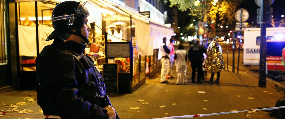 PHOTO: A policeman stands guard near the Boulevard des Filles-du-Calvaire after an attack, Nov, 13, 2015 in Paris.