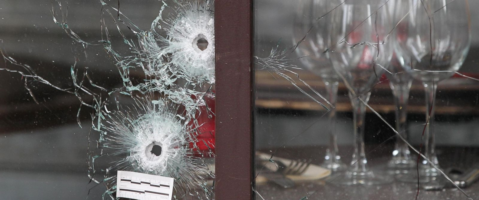 "PHOTO: Bullet holes are seen at ""La Belle Equipe"" restaurant in 11th district of Paris on Nov. 14, 2015 following the terrorist attacks."