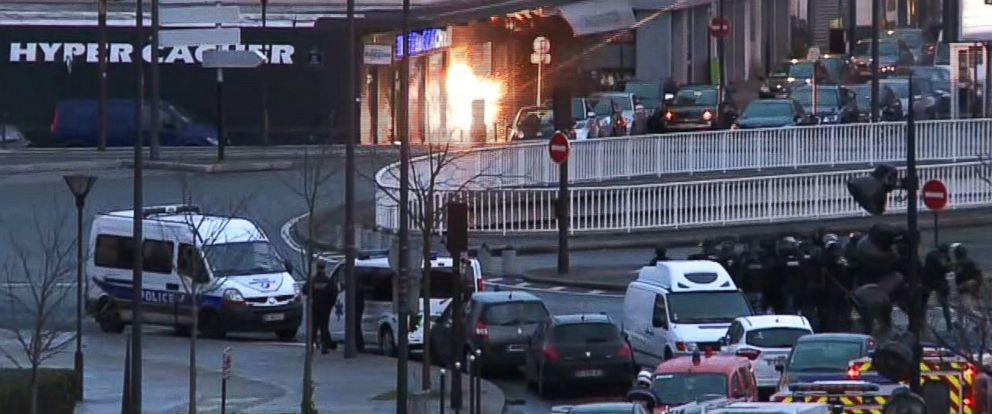 PHOTO: A screengrab taken from an AFP TV video shows members of the French police special forces launching the assault at a kosher grocery store during a hostage-taking drama in Porte de Vincennes, eastern Paris, on Jan. 9, 2015.