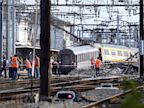 PHOTO: Rescuers work on the site of a train accident in the railway station of Bretigny-sur-Orge on July 12, 2013 near Paris. At least seven people were dead and dozens injured after a speeding train split in two and derailed at a station in the southern