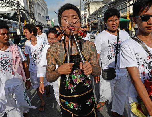 Painful Sword Piercing at the Phuket Festival