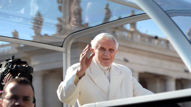 PHOTO: Pope Benedict XVI waves as he arrives on St Peter's square for his last weekly audience, Feb. 27, 2013 at the Vatican.