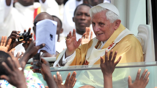PHOTO: Pope Benedict XVI waves to faithfuls as he leaves after celebrating a mass at the Friendship Stadium in Cotonou, Nov. 20, 2011.