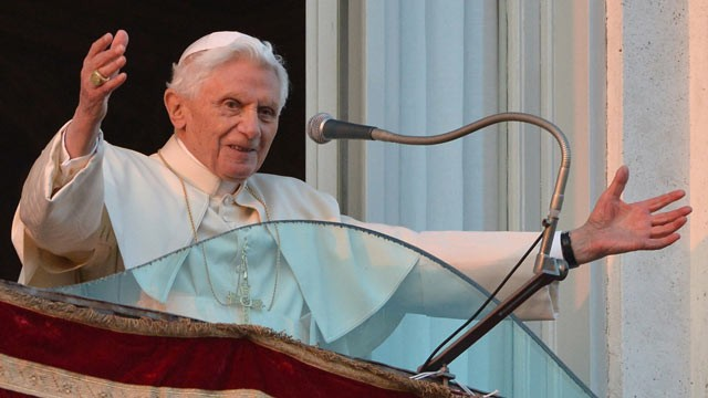 PHOTO:&nbsp;Pope Benedict XVI waves to faithful from a balcony upon arrival in Castel Gandolfo on February 28, 2013.