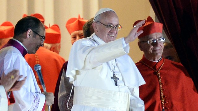 PHOTO: Argentina's cardinal Jorge Bergoglio, elected Pope Francis I appears with cardinals at the window of St Peter's Basilica after being elected the 266th pope of the Roman Catholic Church on March 13, 2013 at the Vatican.