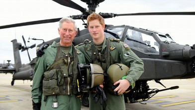 PHOTO: Prince Harry, with his father, Prince Charles, the Prince of Wales, stand in front of an Apache Helicopter at Middle Wallop on the Apache Conversion Course, April 17, 2011.