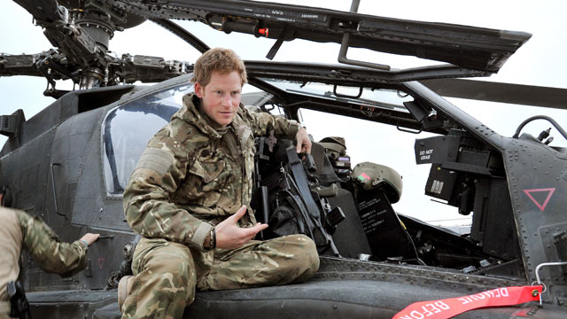 PHOTO: In this image released on January 21, 2013, Prince Harry, makes early morning checks as he sits on an Apache helicopter at the British controlled flight-line at Camp Bastion on December 12, 2012 in Afghanistan.
