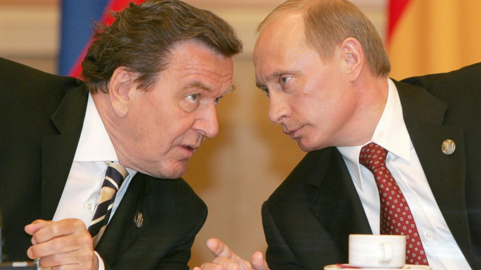 PHOTO: Russian President Vladimir Putin (R) talks to and German Chancellor Gerhard Schroeder during their meeting in Moscow, May 9, 2005.