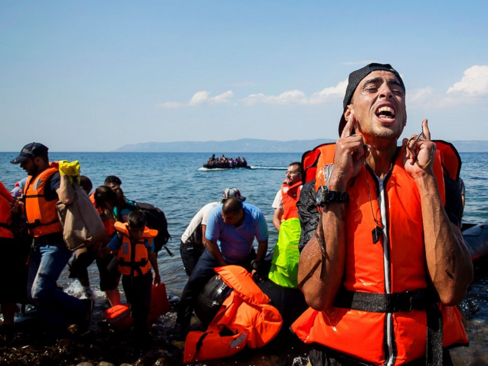 PHOTO: A refugee reacts after coming ashore near the village of Skala Sikamineas on Sept. 8, 2015 in Lesbos, Greece.