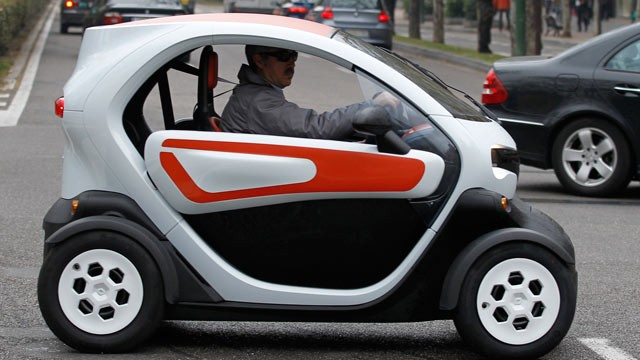 PHOTO: A Renault operator drives a Renault Twizy electric car around Valladolid, Spain, April 03, 2012.
