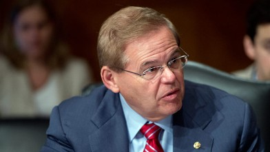 PHOTO: Sen. Robert Menendez, D-N.J., takes his seat for a Senate Banking, Housing and Urban Affairs Committee hearing on May 24, 2012.
