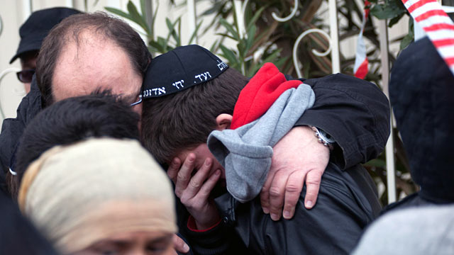 PHOTO: School children are comforted at the scene of a fatal shooting after a gunman opened fire outside the Ozar Hatorah school, March 19, 2012 in Toulouse, France.