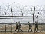 PHOTO: South Korean soldiers patrol along a military fence near the demilitarized zone (DMZ) dividing the two Koreas in the border city of Paju on April 5, 2013.