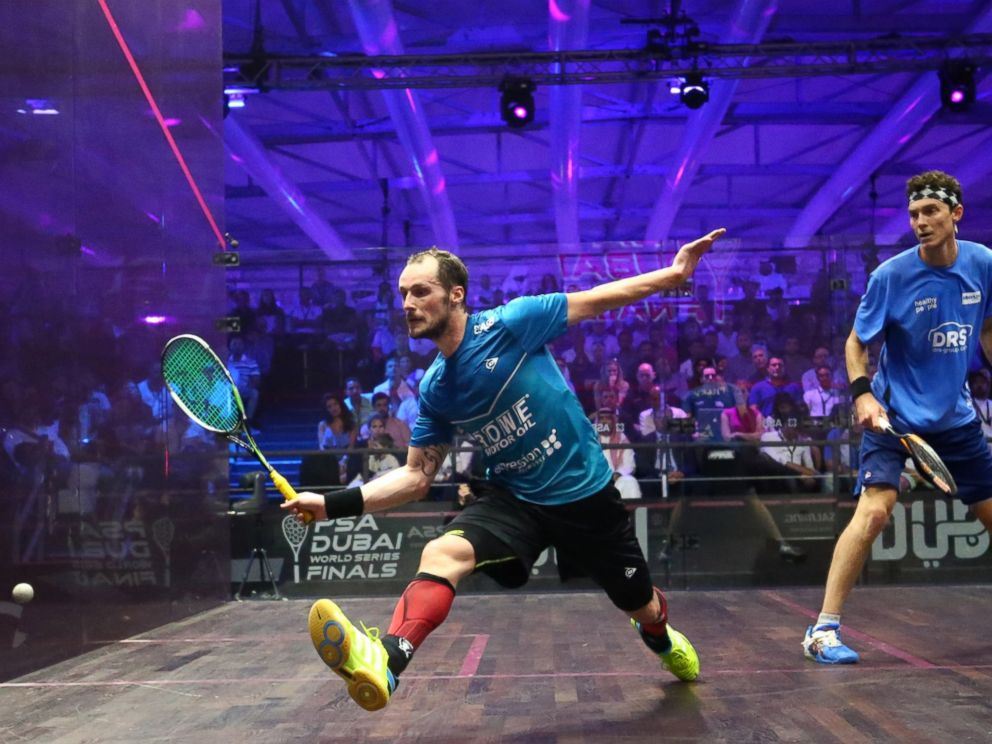 PHOTO: Gregory Gaultier of France plays a forehand to Cameron Pilley of Australia in the mens final match of the Dubai PSA World Series Finals squash tournament in Dubai on May 28, 2016.