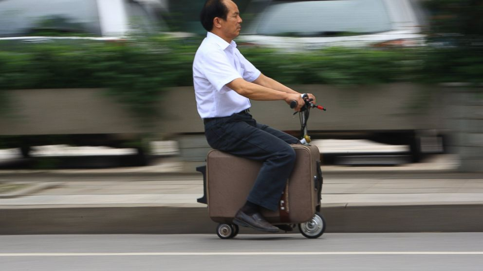 PHOTO: He Liangcais motorized scooter suitcase can travel up to 12.5mph, rivaling your average motorized scooter.