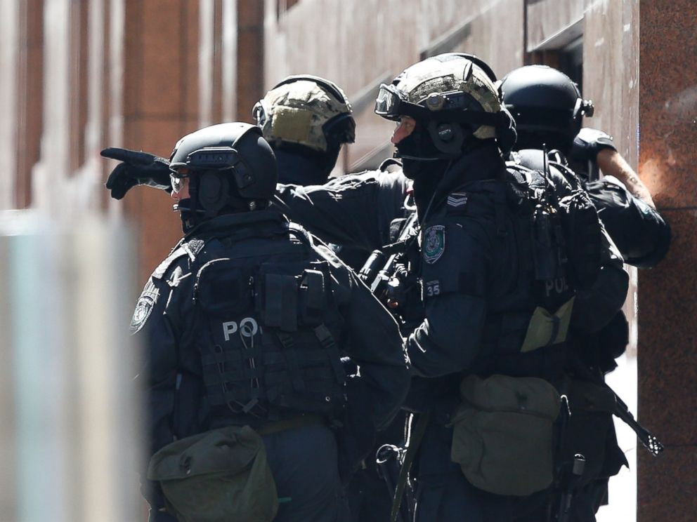 PHOTO: Police officers chat on the scene of the siege at Lindt Cafe in Martin Place on Dec. 15, 2014 in Sydney, Australia.