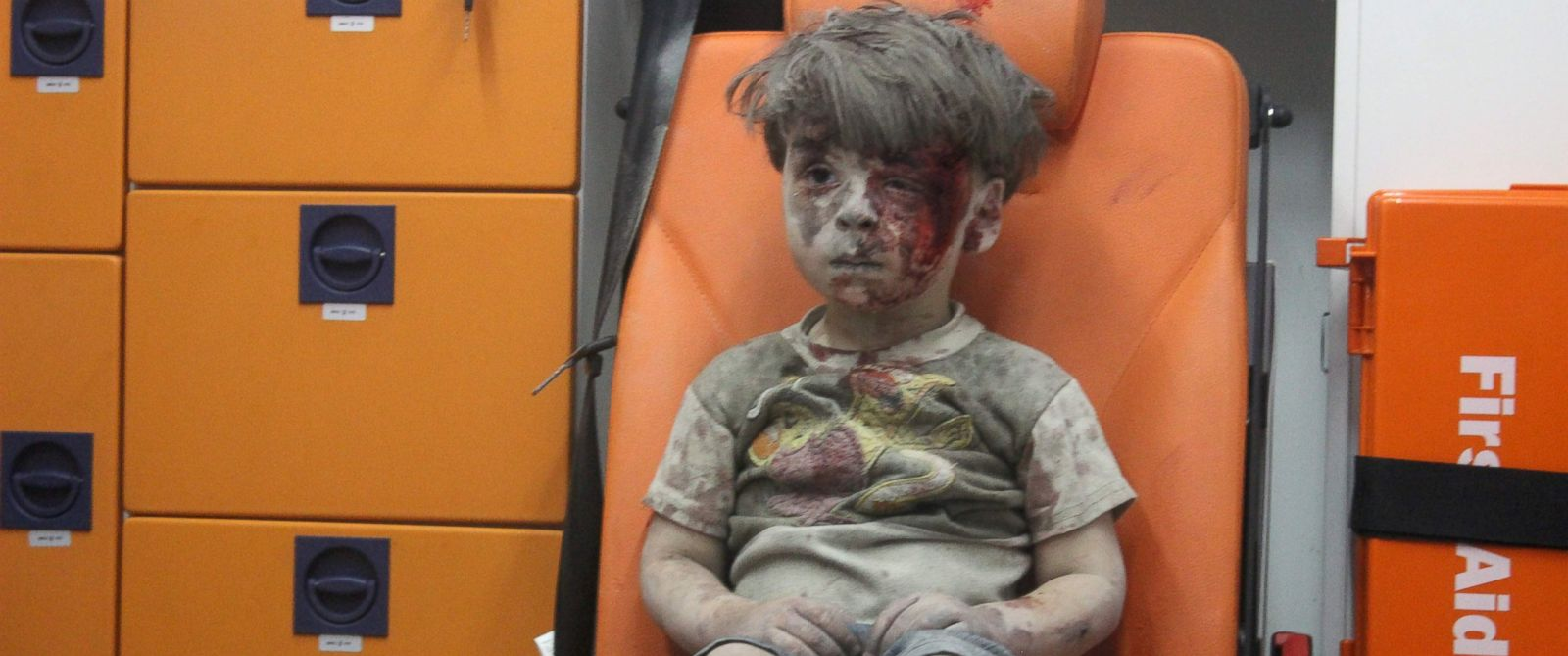 PHOTO: Omran Daqneesh, 4, sits in an ambulance after being rescued from the rubble of a building hit by an air strike in the rebel-held Qaterji neighborhood of the northern Syrian city of Aleppo late on Aug. 17, 2016.
