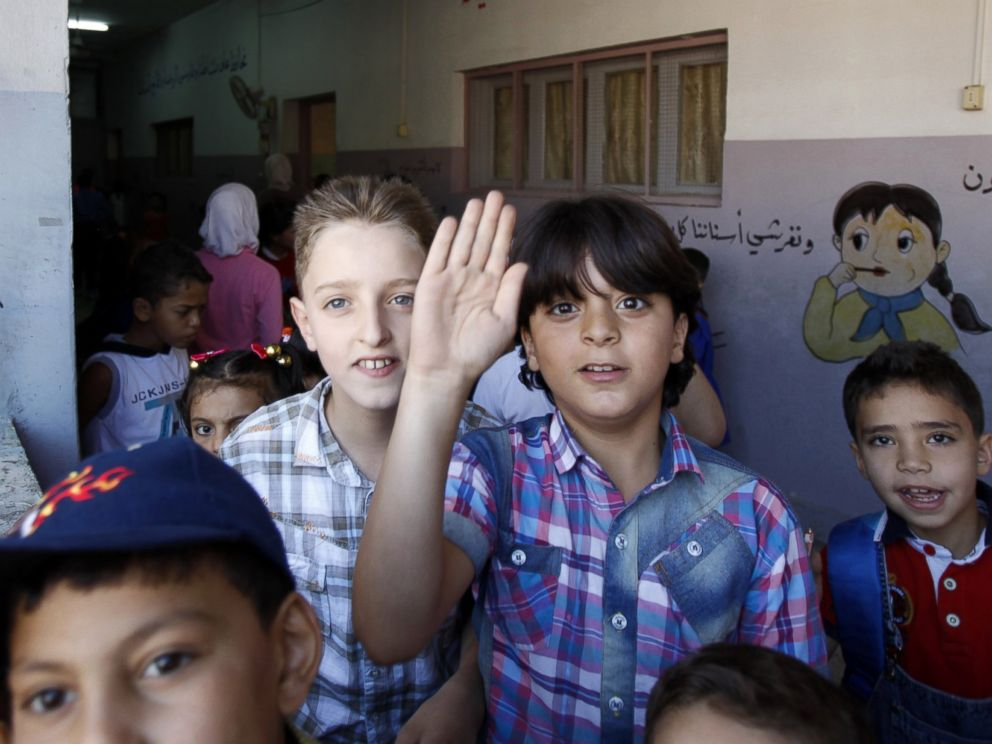 PHOTO: Syrian children walk in a corridor at a school on Sept. 14, 2014 on the first day of the new school year in the Syrian capital Damascus.